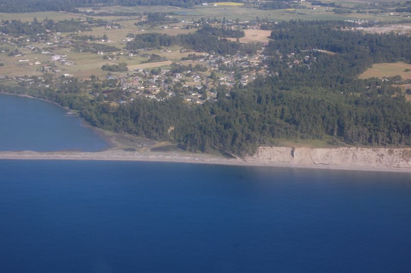 Base of Dungeness Spit as seen from a B-17 Flying Fortress - My house is just about in the center of the trees on the bluff in that hole!